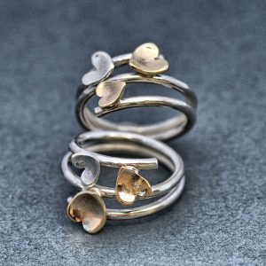 Heart rings in gold and silver